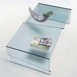 Журнальный столик выполненый из единого куска стекла. Несколько уровней основной поверхности