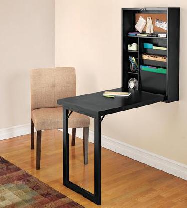 Откидной стол крепится к стене. Черного цвета