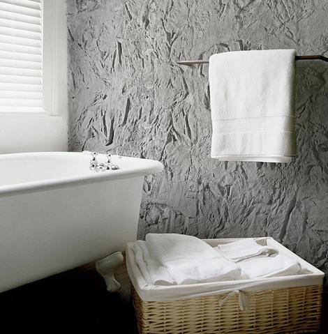 Фото ванной комнаты оформленной настенными декоративными панелями.