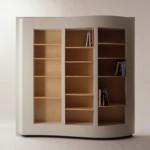 Этот стеллаж ближе к книжному шкафу. Оригинальныя округлая форма, оригинальной цветовое решение.