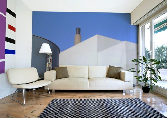 Индустриальный пейзаж, несколько однотонных геометрических поверхностей. Фотообои поддерживают общую стилистику интерьера.