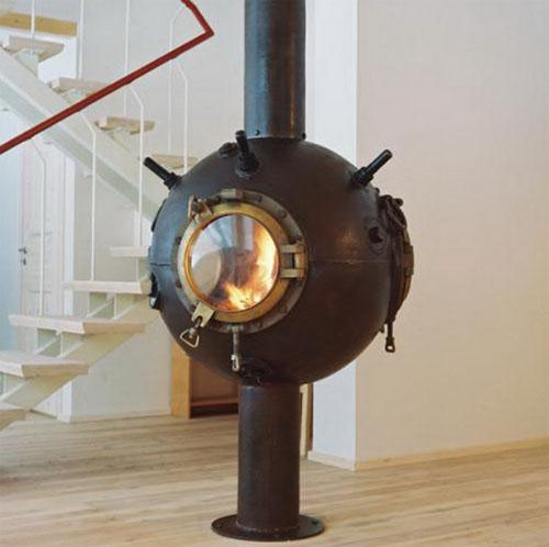 Круглый железный камин из корпуса мины