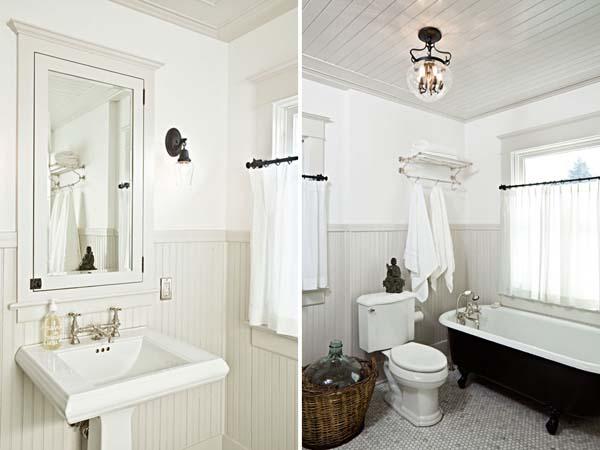 Ванная комната в белом цвете с черной отдельно стоящей ванной