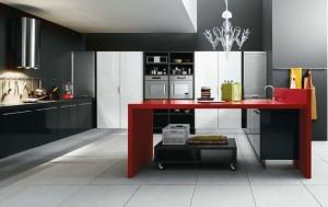 Дизайн черной кухни с яркими красными акцентами