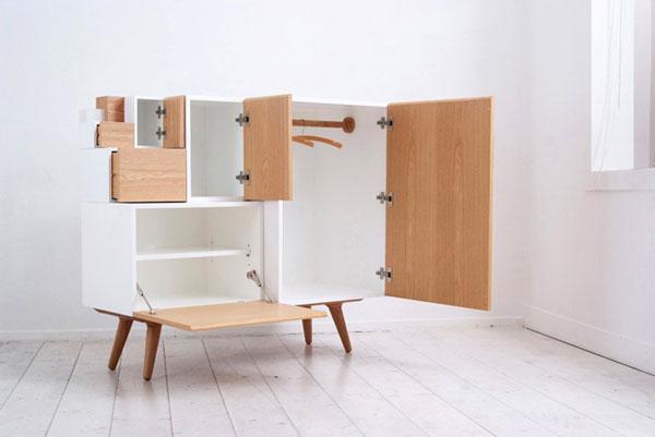 Шкаф из ящиков разной высоты и ширины