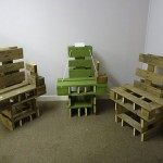 A set of chairs made of wooden pallets