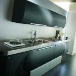 Темная кухня с полу-круглыми тумбами и шкафами