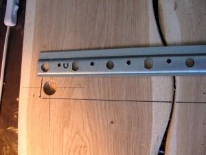 Стальной профиль для крепления досок на стену