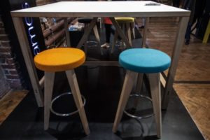 Backless-colorful-stool-with-felt-seat-in-orange-and-blue