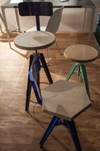 Industrial-stools-with-colorful-base-and-hexagonal-wood-seat